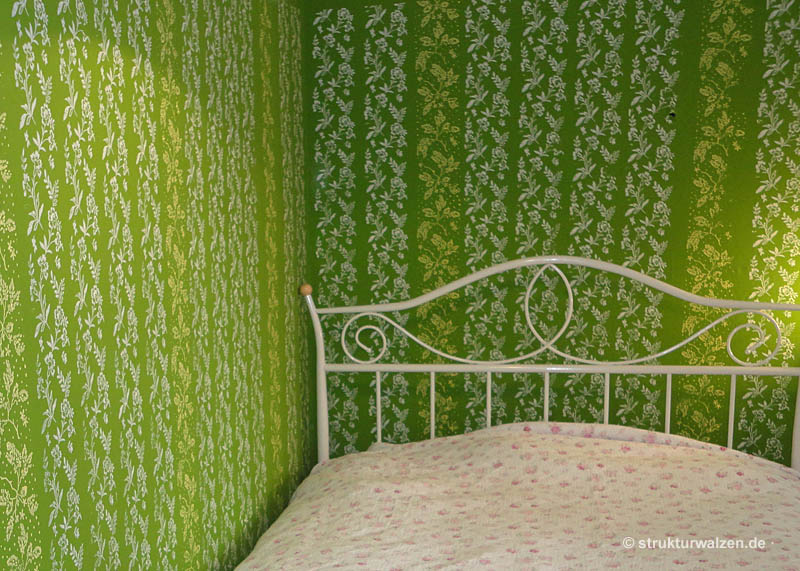 green wall with rolled patterns
