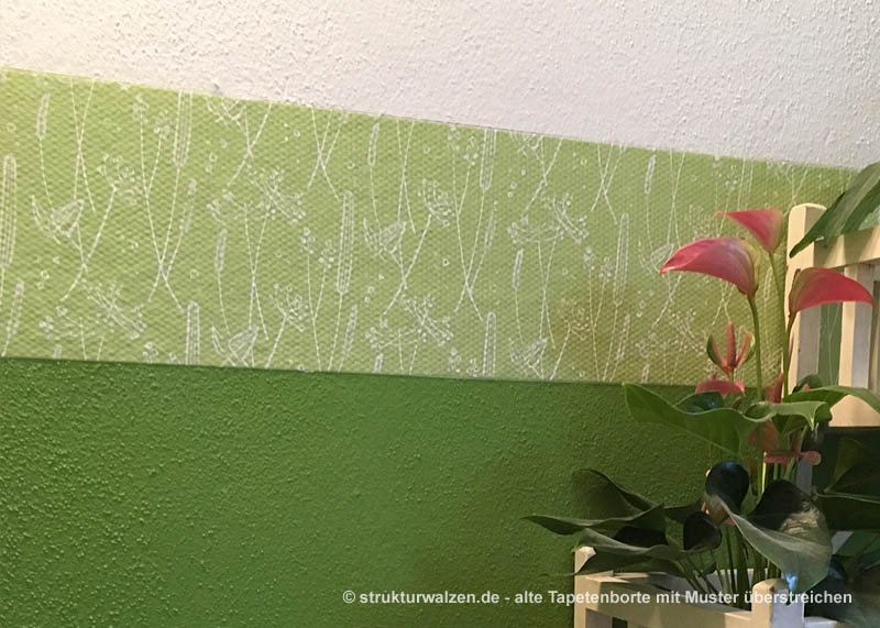 old wallpaper border with pattern overpainting