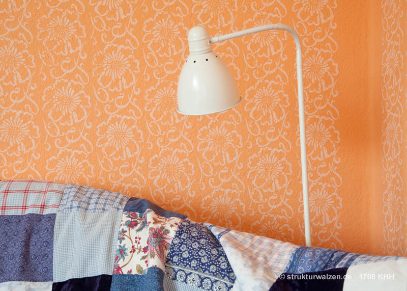 Orange wall with flower pattern